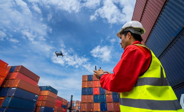 drone operator in a container warehouse